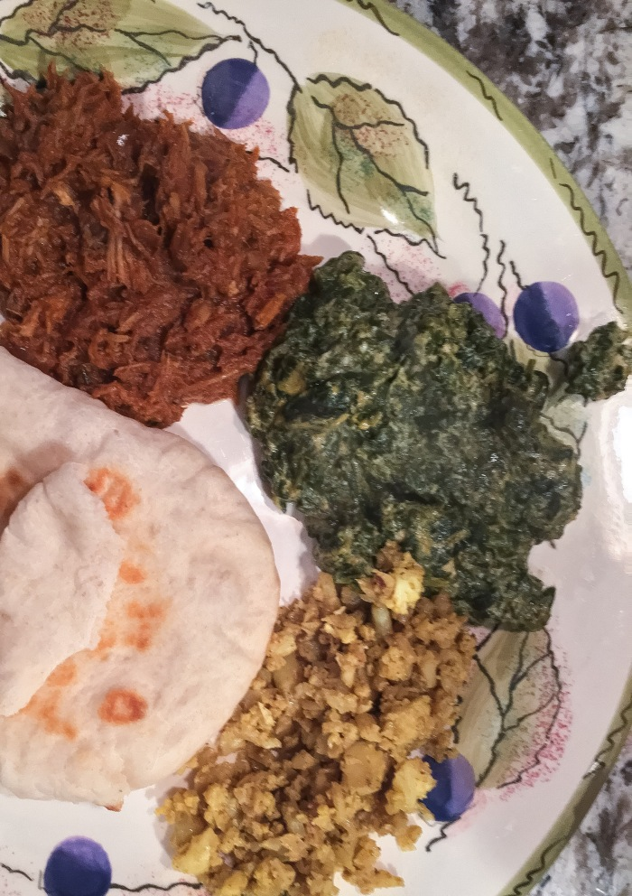 Delicious Indian dinner - Indian BBQ pork, vegan palak paneer, cauliflower rice and naan.